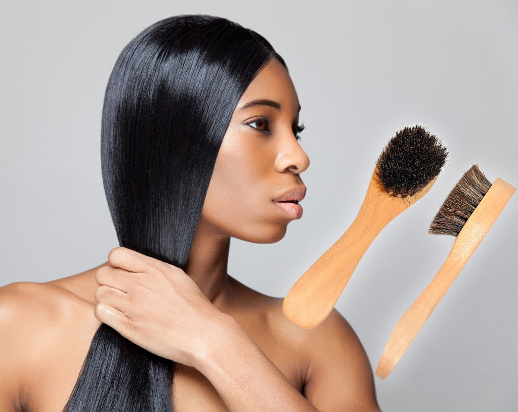 beautiful black woman with 2 Face Brushes